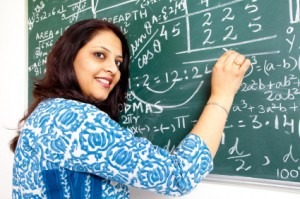 Young Indian Mathematics Teacher in a Classroom